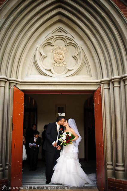 Laura and Elvis's Wedding-church door kisses