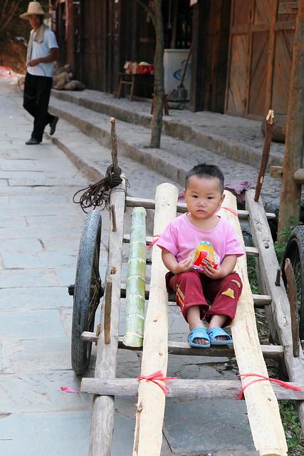 A boy on the cart, Chengyang, Guangxi, China
