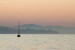 Goleta Bay Sunrise I (Kimmo J) Tags: california sea summer usa water sunrise canon boat hills canon70200f4l shilouttes canonef70200mmf4lisusm