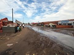 Heaven above, Hell below (mysaliva) Tags: road blue bike clouds town skies tour mud bad olympus dirty sewage motorcyle ep2 innermongolia northeastchina