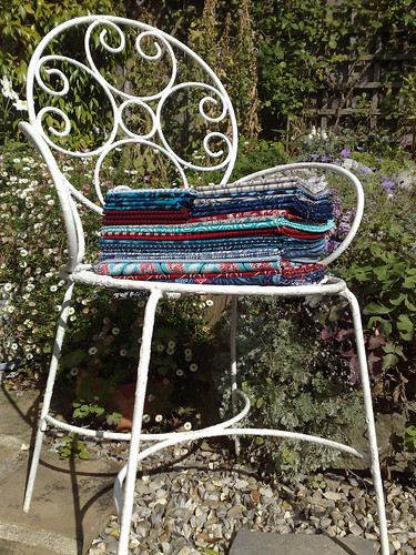 The fabric stash on a nice chair in an even nicer garden