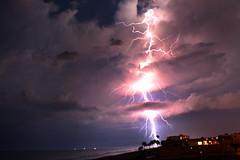 Atlantic Ocean Lightning Strike (thisisbrianfisher) Tags: ocean storm tree beach dark evening energy florida brian shoreline palm shore fisher lightning daytona thunder kaytee outrigger ormond thisisbrianfisher kayteeb bbcbang