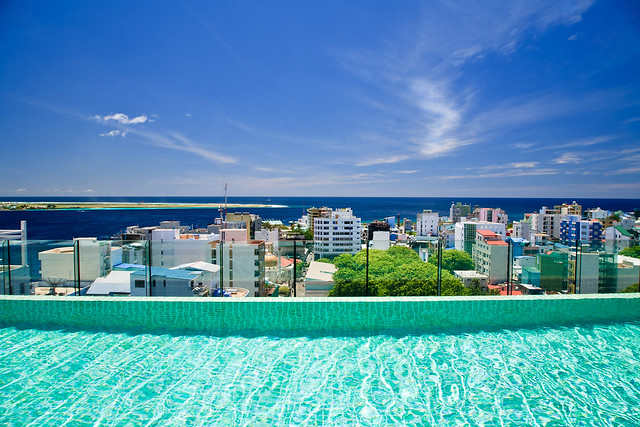 Roof top swimming pool and beautiful view to Male' (Maldives)