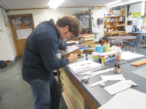 Josh working on book repair