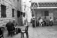 The backgammon friends (Noa Ka) Tags: world life street camera people bw game men art photography israel photo blackwhite play emotion chairs market photos jerusalem fujifilm situation iraqi backgammon 2010 s5700