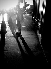 Soaking it in (stephieseye) Tags: street light bw sun boston shadows candid figure soaking iphone brightoncenter day271 365project 271365 yiip iphoneography 9292010