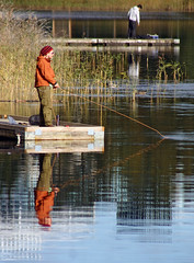 Gone Fishing (Steffe) Tags: lake canon sweden fisher haninge rudan handen refelection angler
