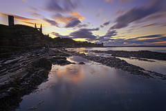 Castle sunset. (Stuart Stevenson) Tags: longexposure sky seaweed history beach water clouds scotland moving rocks fife tide ruin scottish historic coastal northsea standrews bishops picturesque bythesea standrewscathedral standrewscastle castlesands rockypromontory episcopalresidence