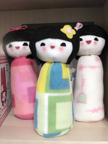 Here are my three Kokeshi dolls I made for Plush You standing on my book case.