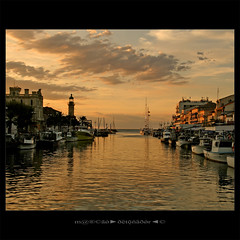 El Faro y el Canal (m@tr) Tags: sunset france canon tamron legrauduroi canoneos400ddigital mtr marcovianna tamron18200mmf3563diiixr portlacamargue imagenesdefrancia fotosdefrancia