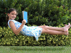 light reading (Laurarama) Tags: girl reading education child dress floating levitation explore gravity zerogravity whimsical levitate nothankyou ourdailychallenge collectionp
