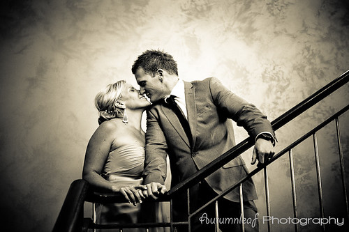Angela & Jason's Wedding - A quick kiss at the stairs
