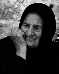 What does this young girl think will happen when she smiles to him this way?! (ybiberman) Tags: portrait bw woman al veil jerusalem isreal churchoftheholysepulchre oldcity portre quds elkuds streetphotographycandidstreetportrait