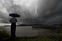 Looking over the River Mandovi and the Sea at Panjim Goa - It is Monsoon Time (Anoop Negi) Tags: sea portrait cloud india storm rain weather clouds umbrella river dark photography for photo media day image photos nimbus delhi indian bangalore goa creative images front best rainy monsoon po arabian mumbai kala anoop climate raj rains panjim mandovi monsoons negi kumar blye akademy panaji photosof ezee123 bestphotographer imagesof anoopnegi jjournalism