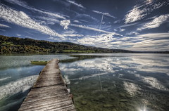Lac Saint-Point (Philippe Saire || Photography) Tags: sky lake france reflection nature water clouds canon landscape eos eau lac sigma wideangle ciel shore 1020mm nuages paysage reflets hdr franchecomt ponton gettyimages barque jete photomatix saintpoint 450d topazadjust philippesaire