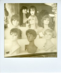 The Creepy Mannequins of Old Town (Eric Spiegel) Tags: window monochrome alexandria shop analog print polaroid virginia women mannequins display tip dcist wigs kingstreet oldtownalexandria wigshop instantfilm instantprint botique silvershade theimpossibleproject polaroid600coolcam px600uv