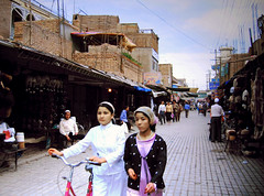 kashgar - where time was forgotten and stopped (Xuan Che) Tags: 2005 china street city travel girls friends summer portrait west history children pretty august oasis xinjiang silkroad kashgar uyghur bazaar centralasia canonixus400 islamic eurasia