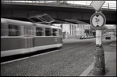Streetcar, Prague - Smichov (tpeltan) Tags: street bridge blackandwhite bw white black car prague minolta documentary tram smichov f 100 pan himatic rodinal ilford r09 fomadon