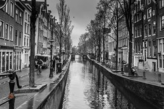 amsterdam canal (Ntino Photography) Tags: amsterdam netherlands blackwhite monochrome outdoor canoneos5dmarkiii canon35mmf2 city water houses buildings sky clouds people spring