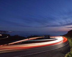Coastal Photon Loop (RZ68) Tags: coast highway pch 1 one hairpin curve turn light trails blue hour sky clouds sunset sea ocean pacific cars traffic long exposure rz67 velvia provia e100 tight loop sonoma county california jenner grade
