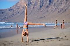 Fun at the beach (RafalZych) Tags: fun beach sand ocean playa famara lanzarote canary islands island summer fuji xe1 fujinon 50230
