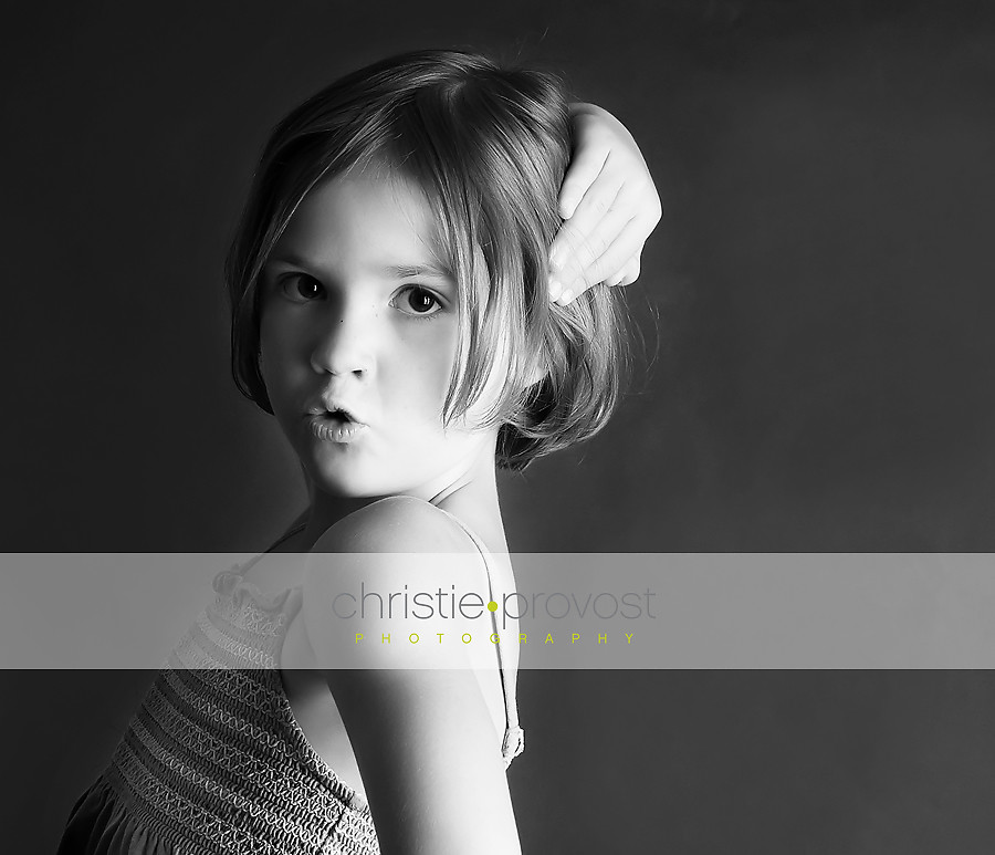 black and white portrait of a little girl in studio lighting