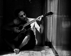 the guitar man_bw (marbleplaty) Tags: nikon philippines july bicol crappy assorted 2010 daraga legazpi albay d80 marbleplaty thechallengefactory paoloarroyo herowinner pregamewinner