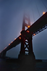 Golden Gate Bridge at Dusk from below (Greg - AdventuresofaGoodMan.com) Tags: sf sanfrancisco california ca bridge fog night lights bay harbor boat goldengatebridge bluehour redandwhitefleet nikond80 greggoodman