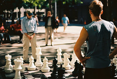 A game of thought (bites a wolf) Tags: seattle old playing game men slr film 35mm canon 50mm young chess strangers thinking a1 canona1