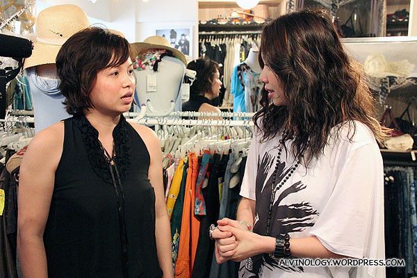 Celia chatting with Gin to find out her dressing preference