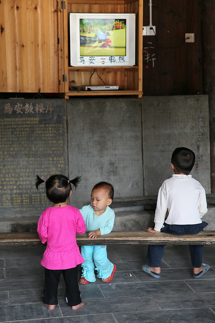 Children in the drum tower, Chengyang, Guangxi, China