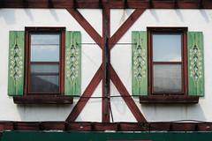 Swiss Shutters (Night Owl City) Tags: usa wisconsin town swiss shutters newglarus greencounty paintedflowers