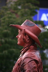 Copper Cowgirl at Dusk (Isleofhope) Tags: woman canada hat statue harbor bc waterfront britishcolumbia profile victoria human copper pacificnorthwest cowgirl pigtails buskar