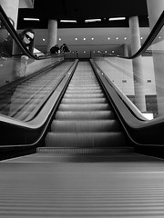 Escalator at the Melbourne Convention & Exhibition Centre during Aussiecon 4 (artisanat) Tags: blackandwhite white delete10 delete9 delete5 delete2 all delete6 delete7 save3 melbourne delete8 delete3 delete delete4 save save2 panasonic save4 save5 worldcon dmu worldsciencefictionconvention lx3black deletedbydeletemeuncensored aussicon4
