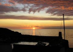 Dunure sunset (crusader752) Tags: sunset scotland ruins shadows fireinthesky irishsea firthofclyde cloudsonfire dunureharbour
