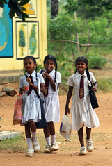 Back to school (Ghadeer Q) Tags: travel school girls smile canon happy uniform asia srilanka schoolgirls giggles backtoschool habarana canon70200 ghadeerq summer2010