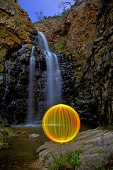 Ball of Light - At the falls (biskitboy) Tags: longexposure orange lightpainting color art canon ball waterfall bright orb balls sphere round adelaide orbs morialta balloflight adelaidehills morialtafalls 5dmkii 5dmk2 colourbrightcolors