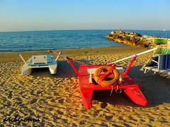 quasi sera (archgionni) Tags: blue red sea summer italy sun beach water boats sand italia mare estate stones blu barche sole acqua rosso spiaggia sabbia scogli