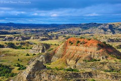 Painted Canyon (Scottwdw) Tags: light red sun nature rock clouds landscape nikon horizon northdakota badlands geology 28300mm vr visitorcenter paintedcanyon medora buttes theodorerooseveltnationalpark scoria d700 yourphototips