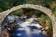 The Old Packhorse Bridge and the River Dulnain, Carrbridge, Scotland (iancowe) Tags: park bridge river scotland highlands long exposure scottish national aviemore cairngorm carrbridge speyside oldbridge packhorse badenoch dulnain theunforgettablepictures