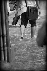 Monsoon (Kieran Harkin) Tags: bw water rain puddle thailand shoes bangkok monsoon thai