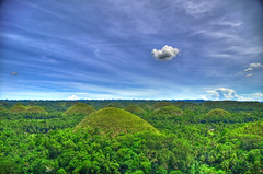 Chocolate Hills (Bohol, Philippines)  (View on Black)  (kthxbai) (mendhak) Tags: trees wallpaper green rain clouds forest chocolate legends limestone bohol local poo fecal superstition hdr wispy fossils feces wisps chocolatehills carabao tayzonday mendhakwallpaper mendhakwebsite