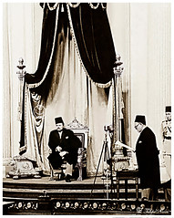 King Farouk sits on the throne as he listens to Premier Mustafa El-Nahhas Pasha read the King's address at the Opening of Parliament On November 17, 1951 (Tulipe Noire) Tags: africa king egypt middleeast parliament farouk cairo 1950s egyptian mustafa premier throne pasha 1951 nahhas