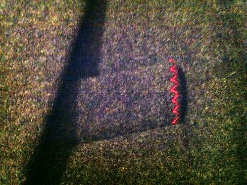 Pink thread, gray wool