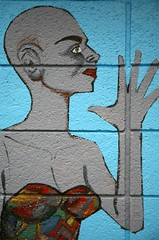 bald grey boots woman closeup (Studiobaker) Tags: street blue people woman streetart building art up saint minnesota fashion silhouette wall closeup concrete outside paul person grey spread dance outfit clothing high hands mural university exterior hand close dress kim dancing skin boots finger background sewing alien fingers gray bald jazz style sew dancer clothes odd hips ave figure heels thumb invader block february feb outline avenue digits alteration mn 2009 invasion collarbone alterations skinned clavicle heeled studiobaker