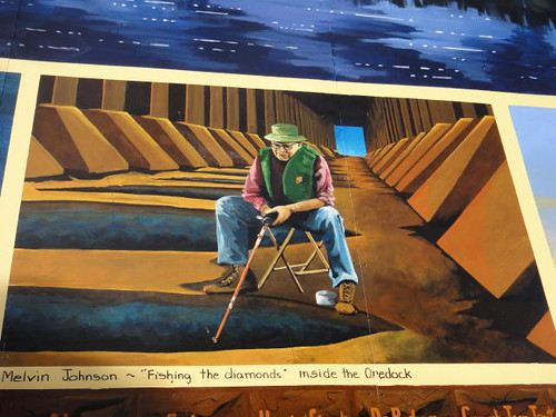 """Melvin Johnson, 'fishing the diamonds' inside the Oredock."""