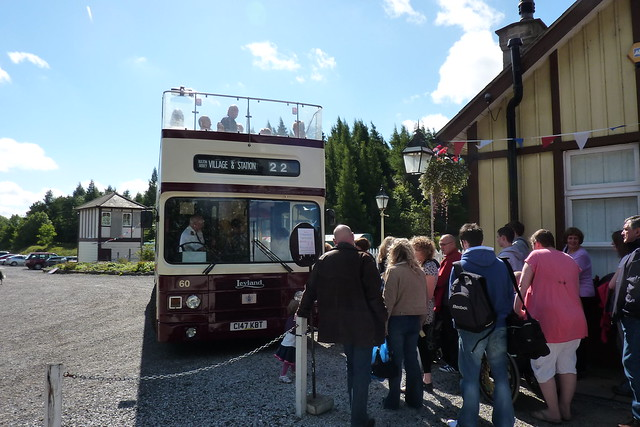 Open top bus outside Bolton Abbey station
