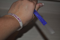 photo of my hand with a new puppy collar around it, mine has my name on it. I'm also holding a new puppy collar in my hand, it is plastic with a colored paper slip inside similar to hospital bracelets