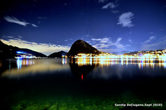 night view of lake lugano (sandip de) Tags: blue light sky cloud mountain lake reflection nature water beautiful night de stars landscape star switzerland long exposure angle wide tokina mm ultra lugano sandip 1116 sandipde