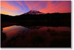 Rainier Sunset Eruption (Don Jensen) Tags: sunset mountain lake reflection 20d clouds canon washington sigma mount rainier 1020